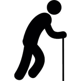 De pie antigua silueta del hombre con un bastón