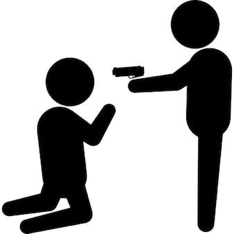 El señalar criminal con un arma de fuego a una persona en las rodillas
