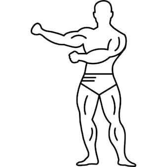 Gimnasta con fuertes músculos en plena vista del cuerpo
