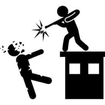 Hombre con una pistola de tiro matar a un zombi de la parte superior de un edificio