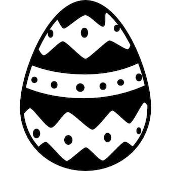 Huevo de Pascua con una línea recta horizontal y dos de rombos todos ellos con pequeños puntos