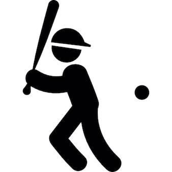 Jugador de béisbol con el bate y la pelota