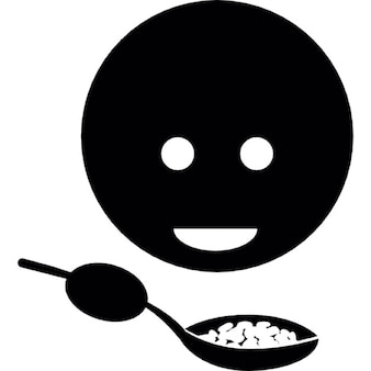 Niño comer alimentos con una cuchara