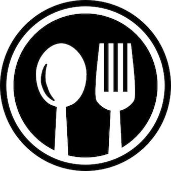 Restaurante de la cuchillería símbolo circular de una cuchara y un tenedor en un círculo