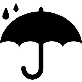 Símbolo de la protección de la silueta paraguas abierto bajo las gotas de lluvia