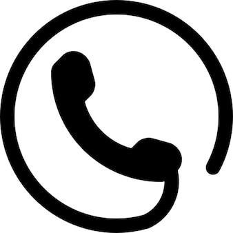 Símbolo de teléfono de un auricular con cable de circular alrededor