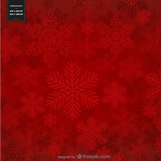 Fond rouge avec des flocons de neige pour Noël