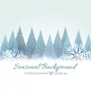 arbres d'hiver avec des flocons de neige fond