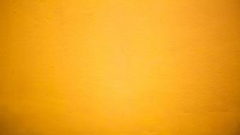 Abstrait Le mur de luxe jaune clair sert à la toile de fond, à l'arrière-plan et à la disposition.