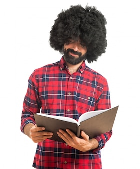 Afro man reading book