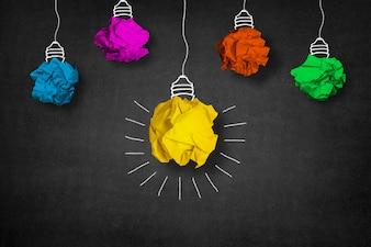 Ampoule faite à partir d'une boule de papier jaune et autres boules autour