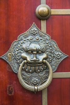 Attelle de porte chinoise