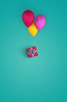 Ballons accrochés à un paquet cadeau