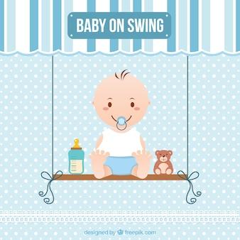 Bébé sur la balançoire
