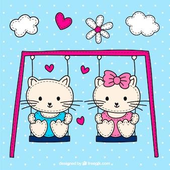 Chats mignons sur la balançoire