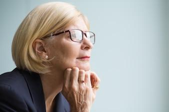 Closeup Portrait of Pensive Senior Business Woman