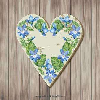 Coeur en bois avec des fleurs