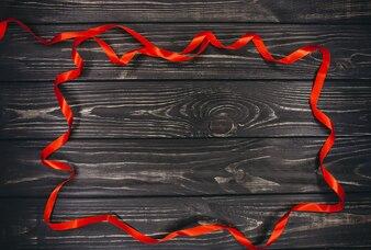 Concept de Noël. bande rouge sur fond en bois