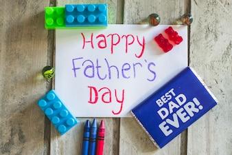 Décoration du jour du père avec des jouets et du chocolat