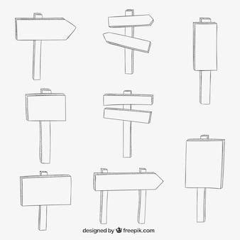 des panneaux en bois dessinés à la main