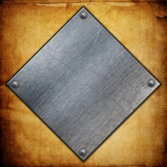 Des plaques métalliques avec des noix sur un fond de papier grunge