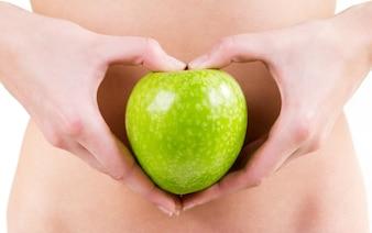 Détail, femme, mains, tenue, vert, pomme