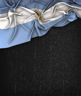 Drapeau de l'Argentine Vintage sur un tableau noir grunge avec un espace pour le texte