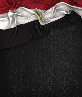 Drapeau Egyptien Vintage sur un tableau noir grunge avec un espace pour le texte