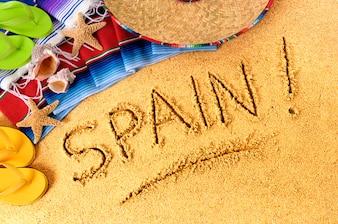Écriture de plage en Espagne