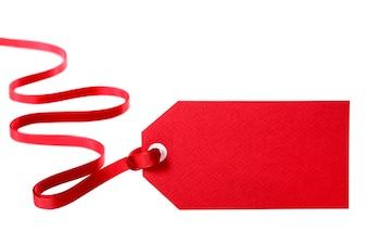 étiquette de cadeau rouge avec un ruban rouge bouclés