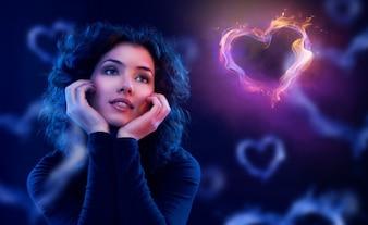 Femme réfléchie sur fond de coeurs