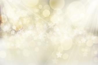 Fond de Noël avec des lumières bokeh et étoiles