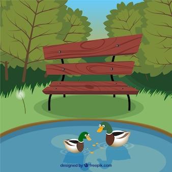 Garez avec banc et le canard dans le lac
