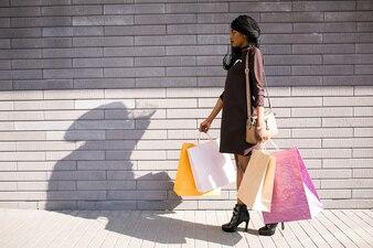Happy african girl american bags