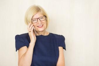Happy Attractive Senior Woman Calling on Phone