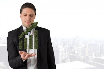 Homme avec une herbe graphique à barres dans leurs mains