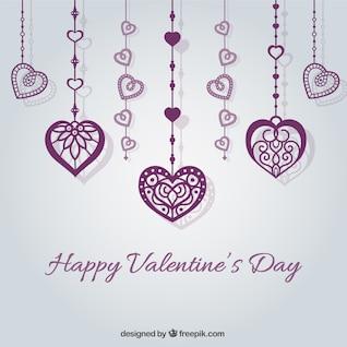 La carte de Saint-Valentin avec des coeurs pourpres