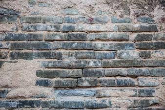 Mur de briques avec du ciment cassé