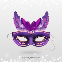 Or masque de carnaval avec des plumes roses