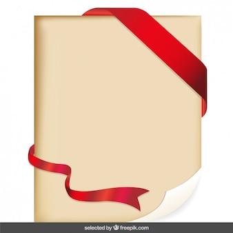 Parchemin avec un ruban rouge