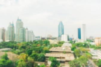 Paysages de la ville industrielle floue - Blur de la ville de Bangkok avec le coucher du soleil et le ciel crépusculaire et la vue bokeh légère forment le toit du bâtiment. Bloc arrière-plan concept.