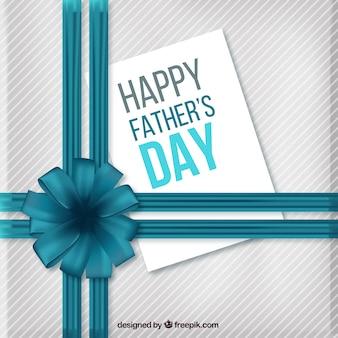 Pères heureux carte de la journée avec un ruban