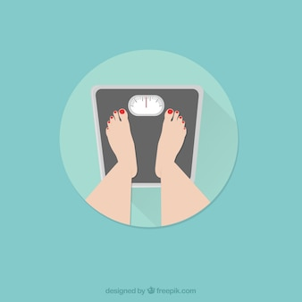 Pieds féminins debout sur une échelle de poids