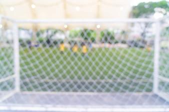 Résumé du terrain de football flou