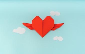 Rouge papier origami coeur avec des ailes et des nuages sur fond bleu