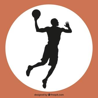 Saut vecteur de joueur de basket-ball