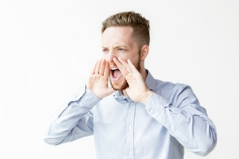 Serious Young Attractive Man Shouting Loud