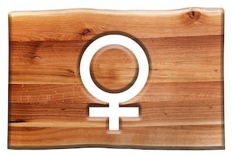 Signe en bois avec le symbole féminin