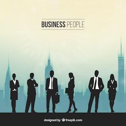 Silhouettes de personnes dans un bureau occupé