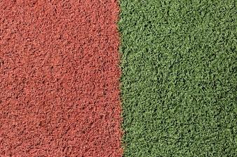 Surface artificielle verte et rouge